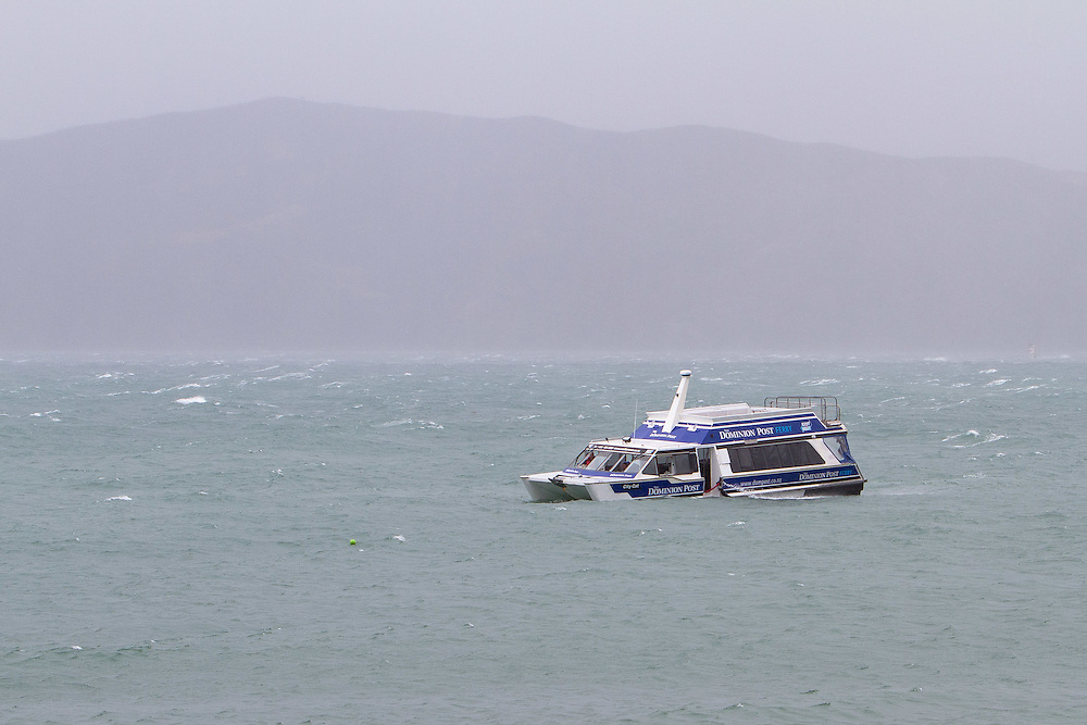 The East-by-West ferry operating in Wellington Harbour in a semi-submerged state after a large wave caused by strong winds smashed the front windows allowing water to swamp the vessel. The passengers including several school children were off loaded. The vessel was saved from sinking at Worser Bay and towed back to the Wellington waterfront. Photo: Gareth Cooke/Subzero Images