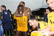 Newport county players Ismail Yakubu © and Aaron O'Connor (top) celebrate after they win the match and book a place at Wembley final.  Blue square bet premier div, play off semi final match, 2nd leg, Newport county v Grimsby Town at Rodney Parade in Newport, South Wales on Sunday 28th April 2013. pic by Andrew Orchard,  Andrew Orchard sports photography,