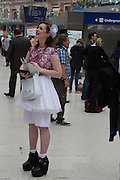 LAURA COLSTON, Royal Ascot racegoers at Waterloo station. London. 20 June 2013.