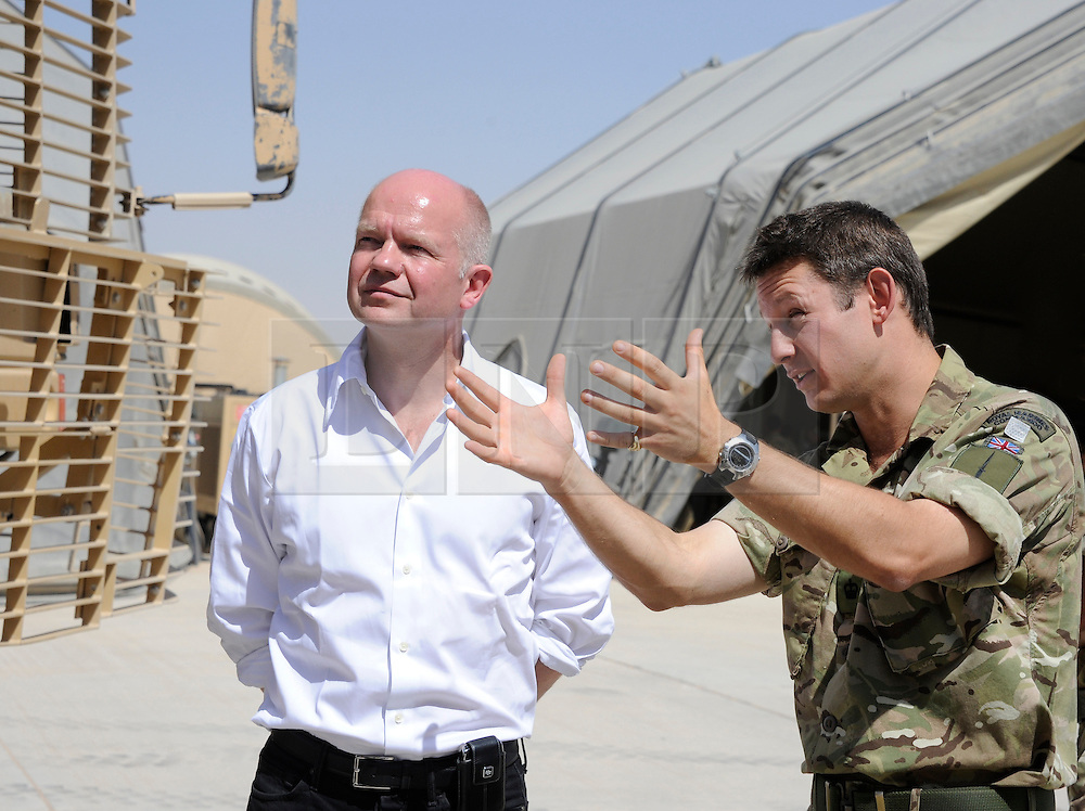 © under license to London News Pictures. Lashkar Gah, Afghanistan  21/06/2011. Picutred - A Major from the Royal Marine Commandos shows Mr Hague the vehicles used in a Combat Logistics Patrol. Foreign Secretary William Hague visits members of the Foreign and Commonwealth Office in Afghanistan today (21/22 Jun 11).  Along with meeting members of the Provincial Reconstruction Team, the Foreign Minister also made time in his schedule to visit British troops in Lashkar Gah and Camp Bastion. Mr Hague was accompanied by the Foreign Minister for the United Arab Emirates, Sheikh Abdullah bin Zayed Al Nahyan. Photo credit should read Alison Baskerville/LNP. Please see special instructions. © under license to London News Pictures