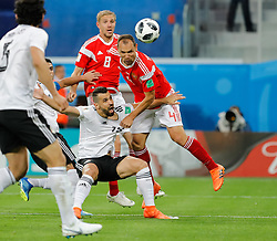 June 19, 2018 - Saint Petersburg, Russia - Sergey Ignashevich (R) of Russia national team and Abdalla Said (C) of Egypt national team vie for a header during the 2018 FIFA World Cup Russia group A match between Russia and Egypt on June 19, 2018 at Saint Petersburg Stadium in Saint Petersburg, Russia. (Credit Image: © Mike Kireev/NurPhoto via ZUMA Press)