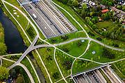 Nederland, Noord-Brabant, Breda, 09-05-2013; infrabundel, combinatie van autosnelweg A16 gebundeld met de spoorlijn van de HSL (re). Stadsduct Overbos in de voorgrond<br /> De bundel loopt in tunnelbakken, lokale wegen gaan over deze infrabundel heen, door middel van de zogenaamde stadsducten, gedeeltelijk ingericht als stadspark. <br /> Combination of motorway A16 and the HST railroad, crossed by  local roads by means of *urban ducts*, partly designed as public  parks. <br /> luchtfoto (toeslag op standard tarieven);<br /> aerial photo (additional fee required);<br /> copyright foto/photo Siebe Swart.