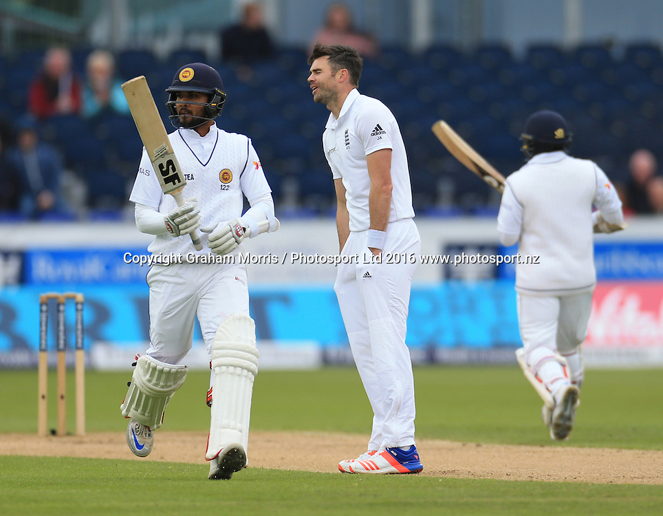 Bowler James Anderson is hit for four by Dinesh Chandimal (left) during the second Investec Test Match between England and Sri Lanka at Chester-le-Street, Durham. Photo: Graham Morris/ Photosport.nz