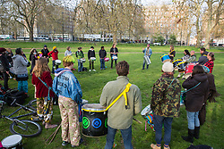 London, UK. 14th April 2019. Climate campaigners from Extinction Rebellion practice drumming in Hyde Park following the Earth March in preparation for 'International Rebellion UK - Shut Down London!' events next week to call on the Government to take urgent action to address climate change.