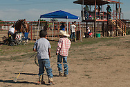 Native Americans, boys,  practice roping, Crow Fair, Indian Rodeo, Montana.