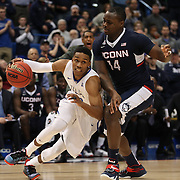 James Woodard, (left), Tulsa, drives past Rakim Lubin, UConn, during the UConn Huskies Vs Tulsa Semi Final game at the American Athletic Conference Men's College Basketball Championships 2015 at the XL Center, Hartford, Connecticut, USA. 14th March 2015. Photo Tim Clayton