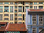 28 DECEMBER 016 - SINGAPORE:  A traditional shophoue in front of a new apartment/condo development in Chinatown, Singapore.    PHOTO BY JACK KURTZ