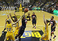 February 24 2011: Illinois Fighting Illini forward Karisma Penn (00) puts up a shot between Iowa Hawkeyes forward Kelsey Cermak (22), Iowa Hawkeyes guard Kachine Alexander (21), and Iowa Hawkeyes forward Kalli Hansen (3) during the first half of an NCAA women's college basketball game at Carver-Hawkeye Arena in Iowa City, Iowa on February 24, 2011. Iowa defeated Illinois 83-64.