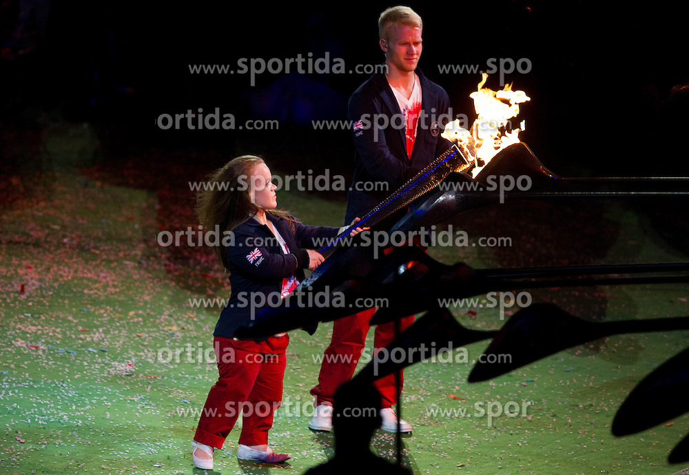 The final flame - the Caulderon opens and Paralympian light their Paralympic Torch from the dying Flame during the closing ceremony of the London 2012 Paralympic Games on September 9, 2012, in Olympics stadium, Stratford, London, Great Britain. (Photo by Vid Ponikvar / Sportida.com)