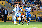 Gaëtan Bong is pressured by James Henry during the Sky Bet Championship match between Wolverhampton Wanderers and Brighton and Hove Albion at Molineux, Wolverhampton, England on 19 September 2015. Photo by Alan Franklin.