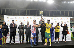 20112018 (Durban)<br /> Paraguay captain Junior Alonso and Bafana captain Thulani Hlatshwayo sharing a trophy after a match were Bafana Bafana and Paraguay have drawn 1-1 in the Nelson Mandela Challenge match played at Moses Mabhida Stadium in Durban on Tuesday evening.<br /> Picture: Motshwari Mofokeng/African News Agency (ANA)