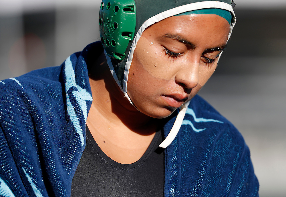 11/3/16 9:20:28 AM -- Orange Empire Conference Water Polo Championships. Golden West College's Marina Corona (14) walks back to the team bench in their game against Santa Ana College. --Saddleback College, Mission Viejo, Ca<br /> <br /> Photo by Joe Bergman / Sports Shooter Academy