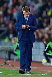 SOUTHAMPTON, ENGLAND - Friday, April 6, 2018: England's head coach Phil Neville makes notes during the FIFA Women's World Cup 2019 Qualifying Round Group 1 match between England and Wales at St. Mary's Stadium. (Pic by David Rawcliffe/Propaganda)