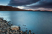 The shore of Lake Kleifarvatn, in the Reykjanes peninsula, during an amazing show of light at midnight