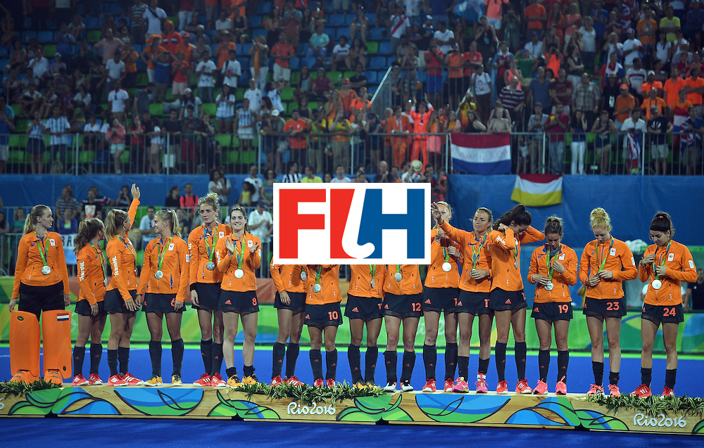 Netherlands' silver medallists celebrate on the podium during the women's field hockey medals ceremony of the Rio 2016 Olympics Games at the Olympic Hockey Centre in Rio de Janeiro on August 19, 2016. / AFP / MANAN VATSYAYANA        (Photo credit should read MANAN VATSYAYANA/AFP/Getty Images)