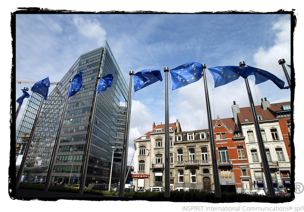BRUSSELS - BELGIUM - 02 JUNE 2005 --EU Flags between the European Commission building Berlaymont and the Charlemagne building and house on Boulevard Charlemagne .-- PHOTO: ERIK LUNTANG / INSPIRIT Photo..