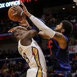 Apr 1, 2018; New Orleans, LA, USA; Oklahoma City Thunder forward Paul George (13) fouls New Orleans Pelicans forward Cheick Diallo (13) during the second half at the Smoothie King Center. The Thunder defeated the Pelicans 109-104. Mandatory Credit: Derick E. Hingle-USA TODAY Sports