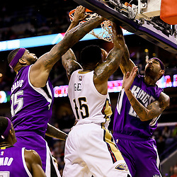 Jan 28, 2016; New Orleans, LA, USA; New Orleans Pelicans forward Alonzo Gee (15) dunks over Sacramento Kings center DeMarcus Cousins (15) and center Willie Cauley-Stein (00) during the third quarter of a game at the Smoothie King Center. The Pelicans defeated the Kings 114-105. Mandatory Credit: Derick E. Hingle-USA TODAY Sports