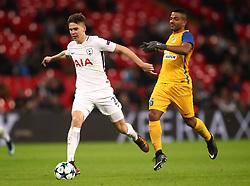 Tottenham Hotspur's Juan Foyth (left) and APOEL Nicosia's Lorenzo Ebecilio (right) battle for the ball