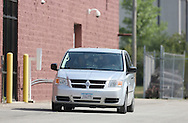A Dodge Caravan holding Russell Wasendorf Sr. exits the back lot of the United States Federal Court of the Northern District of Iowa in Cedar Rapids, Iowa, July 13, 2012.