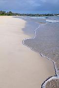The waves slide up on Kailua Beach.