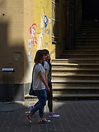 Young foreign girls for a walk through the historic center of Genoa. Giovani ragazze straniere a passeggio per il centro storico di Genova.
