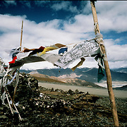Prayer flags on a mountain pass in Tibet
