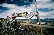 Prayer flags on a mountain pass in Tibet