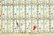 Group of dancers leaping and dancing within the containers of Panama Ports.MR. Model relased photo.