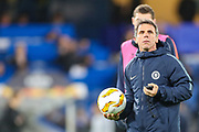 Assistant first team coach, Gianfranco Zola instructs his team as they warm up during the Champions League group stage match between Chelsea and PAOK Salonica at Stamford Bridge, London, England on 29 November 2018.