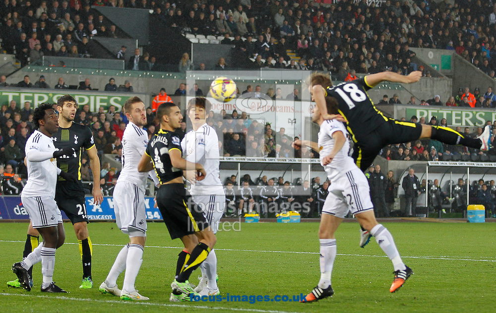 Harry Kane of Tottenham Hotspur heads in the first goal during the Barclays Premier League match at the Liberty Stadium, Swansea<br /> Picture by Mike Griffiths/Focus Images Ltd +44 7766 223933<br /> 14/12/2014