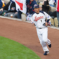 22 March 2009: #1 Kosuke Fukudome of Japan gets back to the dugout after scoring during the 2009 World Baseball Classic semifinal game at Dodger Stadium in Los Angeles, California, USA. Japan wins 9-4 over Team USA.