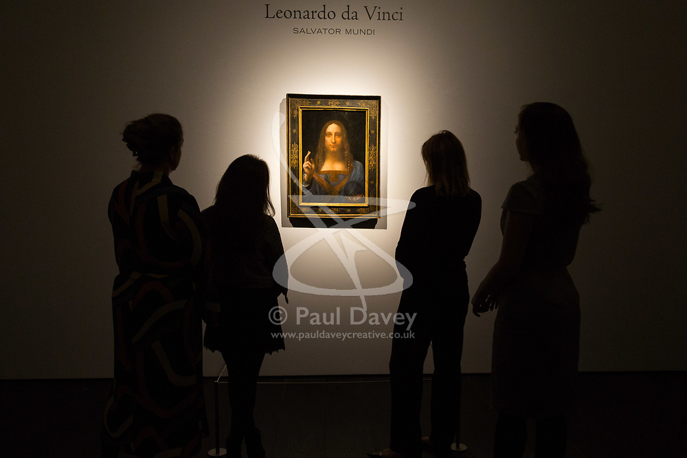 London, October 24 2017. Viewers admire Leonardo da Vinci's Salvator Mundi ('Saviour of the World'), estimated at $100 million at Christie's in London, which will be sold in the Post-War and Contemporary Art Evening Auction taking place on 15 November at Christie's New York. The painting is one of fewer than 20 known paintings by Leonardo, and the only one in private hands. © Paul Davey