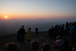 © Licensed to London News Pictures. 21/04/2019. Worcester, UK. Crowds listen to a religious service at sunrise on Easter Sunday, at the Worcestershire Beacon. The Beacon is the highest point in the Malvern Hills at 425m. Easter Sunday is a key date in the Christian calendar. Photo credit : Tom Nicholson/LNP