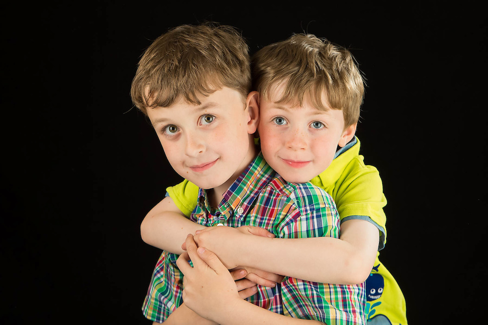 Photo of two brothers in the studio. Mother's day gift.