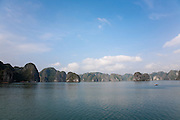 Panorama or limestone karsts and islands in Ha Long Bay with fishing boat and Blue sky, near Cat Ba Island, Vietnam