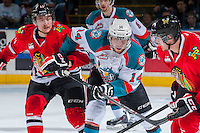 KELOWNA, CANADA - APRIL 25: Adam De Champlain #11 of the Portland Winterhawks checks Rourke Chartier #14 of the Kelowna Rockets on April 25, 2014 during Game 5 of the third round of WHL Playoffs at Prospera Place in Kelowna, British Columbia, Canada. The Portland Winterhawks won 7 - 3 and took the Western Conference Championship for the fourth year in a row earning them a place in the WHL final.  (Photo by Marissa Baecker/Getty Images)  *** Local Caption *** Adam De Champlain; Rourke Chartier;