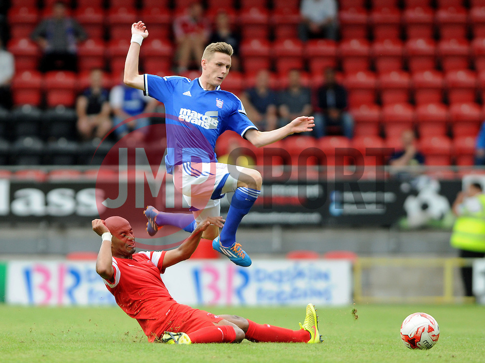 Leyton Orient's Elliot Omozusi tackles Ipswich Town's Alex Henshall - photo mandatory by-line David Purday JMP- Tel: Mobile 07966 386802 02/08/14 - Leyton Orient v Ipswich Town - SPORT - FOOTBALL - Pre season - London -  Matchroom Stadium