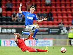 Leyton Orient's Elliot Omozusi tackles Ipswich Town's Alex Henshall - photo mandatory by-line David Purday JMP- Tel: Mobile 07966 386802 02/08/14 - Leyton Orient v Ipswich Town - SPORT - FOOTBALL - Pre season - London -  Matchroom Stadium