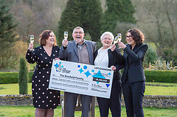 © Licensed to London News Pictures. 20/02/2018. Tortworth Court, Wotton-under-Edge, Gloucestershire, UK. Family of six win £18.1m on Lotto. The BANFIELD family, left-right: daughter Karen, age 51; dad Dennis age 87, mum Shirley age 83, daughter Tina age 54. A family syndicate from Bristol are celebrating after their Lucky Dip ticket matched all six numbers to scoop the £18,139,352 Lotto Jackpot last Saturday. The win, which mum and dad had always told their two daughters was just a matter of time, will mean travel to international sporting fixtures, new cars and a stress-free future for them all. Photo credit: Simon Chapman/LNP