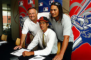 Orioles Director of international scouting David Stockstill with Pita Rona and his father Brad, New Zealand baseball player Pita Rona signs with American Major League Baseball team the Baltimore Orioles. Sky City Grand hotel, Auckland. 19 January 2012. Photo: William Booth/photosport.co.nz