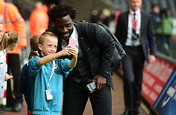 Wilfried Bony of Swansea City has his picture taken with a young fan. - Mandatory by-line: Alex James/JMP - 10/09/2017 - FOOTBALL - Liberty Stadium - Swansea, England - Swansea City v Newcastle United - Premier League