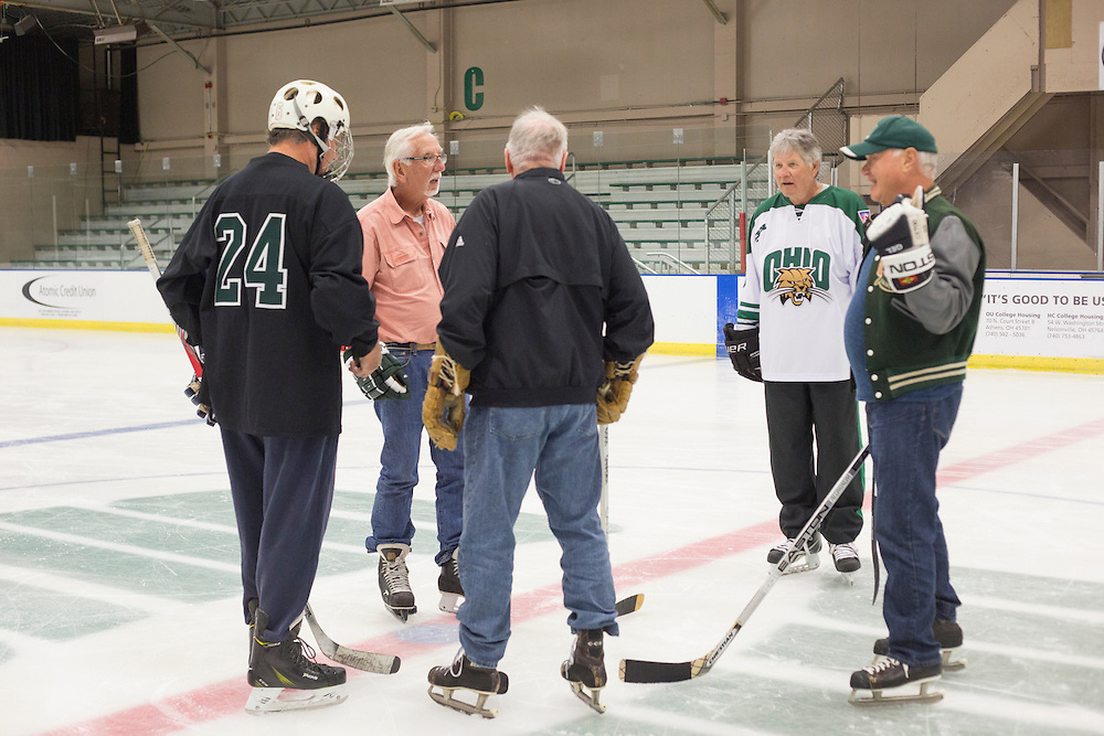 Hockey alumni of the 1960s skate at Bird Arena during their reunion weekend on October 1, 2016.