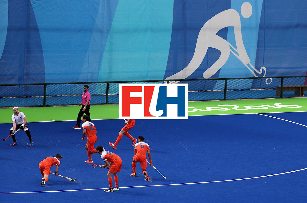 RIO DE JANEIRO, BRAZIL - AUGUST 12:  Team Netherlands take a shot on goal during a Men's Preliminary Pool B match on Day 7 of the Rio 2016 Olympic Games at the Olympic Hockey Centre on August 12, 2016 in Rio de Janeiro, Brazil.  (Photo by Sean M. Haffey/Getty Images)