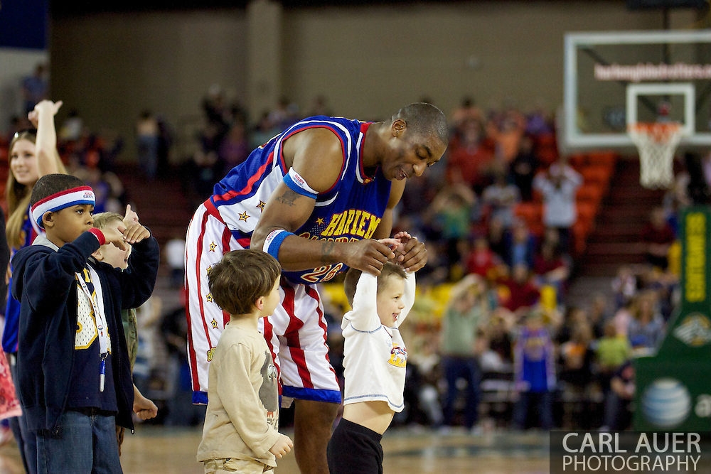 April 30th, 2010 - Anchorage, Alaska:  Hi-Lite Bruton of the World Famous Harlem Globetrotters helps the young fans dance to YMCA during a timeout Friday night at the Sullivan Arena.