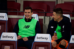 LONDON, ENGLAND - Saturday, November 4, 2017: Liverpool's substitutes Dejan Lovren and Marko Grujic on the bench during the FA Premier League match between West Ham United FC and Liverpool FC at the London Stadium. (Pic by David Rawcliffe/Propaganda)
