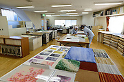 Members of staff work on a plan for a carpet. Oriental Carpet Mills, Yamanobe-machi, Yamagata, Japan, April 11, 2016. Oriental Carpet Mills was founded in 1935 and produces luxury hand-woven and tufted carpets. Its carpets are used all over the world, including in the Vatican, the Imperial Palace in Tokyo and the Kabukiza Kabuki Theatre.