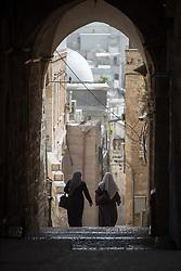14 April 2019, Jerusalem: Two muslim women walk down a street in Jerusalem's Old City.