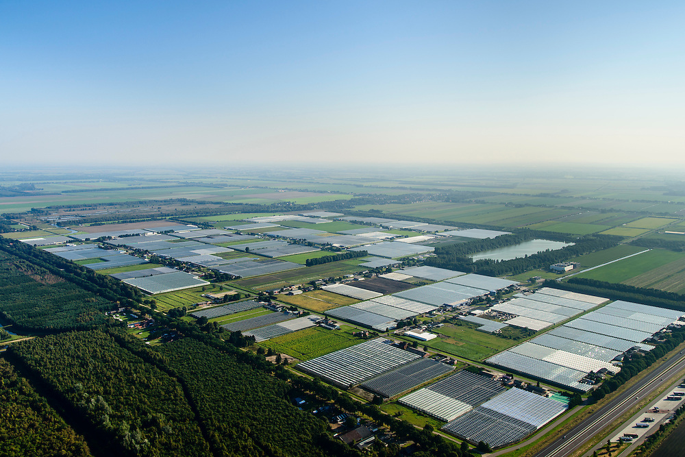 Nederland, Drenthe, Emmen, 28-10-2014; glastuinbouwgebied Klazienaveen, gelegen aan de A37.<br /> Greenhouse area near German border.<br /> luchtfoto (toeslag op standard tarieven);<br /> aerial photo (additional fee required);<br /> copyright foto/photo Siebe Swart