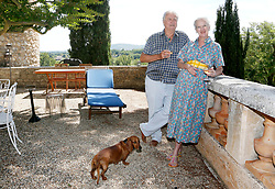 File photo - NO WEB/NO APPS/NO TABLOIDS - SPECIAL FEE REQUIRED - Exclusive. Queen Margrethe II and Prince Consort Henrik of Denmark spend their annual summer vacation at Chateau de Caix, near Cahors, southwestern France on August 14, 2013. The 25-hectare family estate produces about 160,000 bottles of 'Cahors' red, white and rose wine. Prince Henrik prefers red wine (because the grapes are hand-picked), which represents 70% of the castle's production. Best-selling around the world are the 2002 to 2005 vintages called 'La Cuvee du Prince du Danemark, Chateau de Caix, Cahors'. 10% of the Prince's wine are sold in France, 30% are exported in Denmark and 60 % in the rest of the world, mostly in China, where the prince opened 10 wine stores. He also intends to expand to Hongkong and Canada. New this year, are the 4 hectare-vineyard of white wine called 'Cuvee Altesse'. The prince also opened a wine store in Luzech, the village close to the castle, which hosts a renown weekly market. Next year, Prince Henrik wants to produce a 'cuvee speciale' to mark his 80th birthday'. Wine is a family tradition and Queen Margrethe backs her husband's passion. Prince Henrik, the French-born husband of Denmark's Queen Margrethe II, has died, the palace announced Wednesday. He was 83. Photo by Patrick Bernard/ABACAPRESS.COM